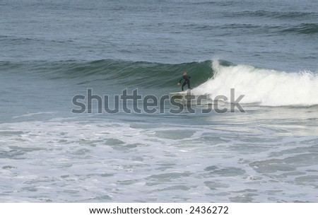 Surfer at Daytona Beach - stock photo
