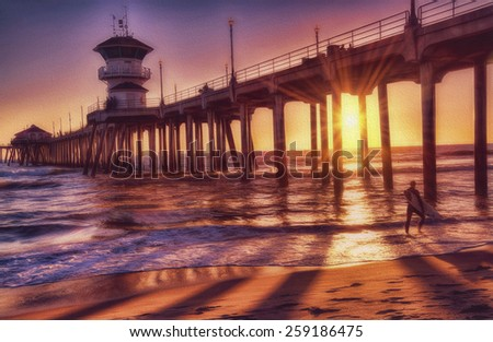 Surfer at Sunset at Huntington Beach Pier, Huntington Beach, California - stock photo