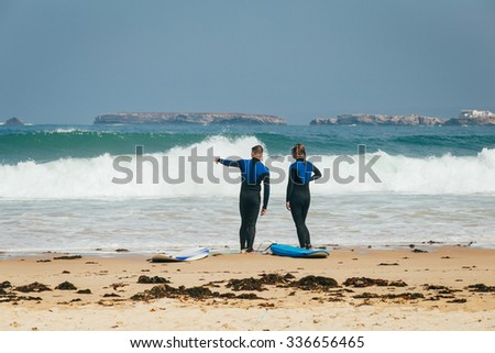 Surfer couple. Family of the surfers - stock photo