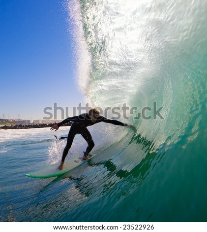 Surfer Ducking into Tube - stock photo