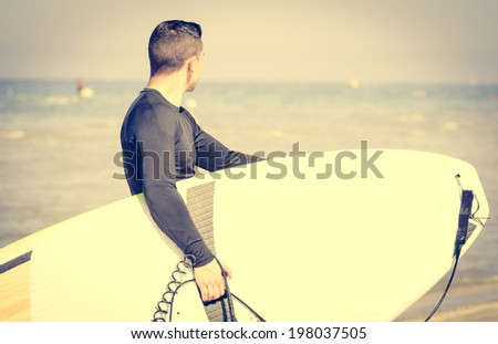 surfer exit the water - stock photo