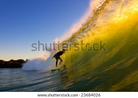 Surfer Gets A California Tube at Sunset - stock photo