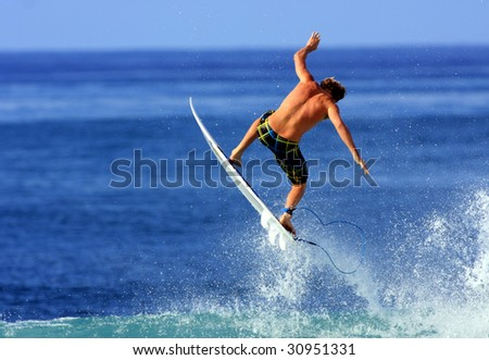 surfer gets air in Hawaii - stock photo