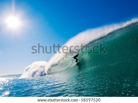 Surfer getting Barreled in California - stock photo
