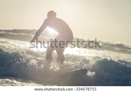 Surfer getting on the wave with his board. Concept about surf and sport - stock photo
