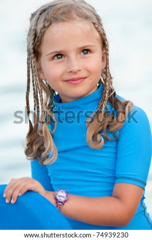 Surfer girl at the beach - portrait