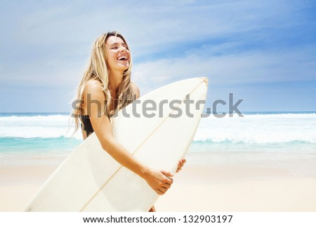 Surfer girl on the beach of bali