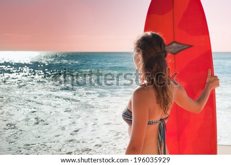 surfer girl with long board near the ocean - stock photo