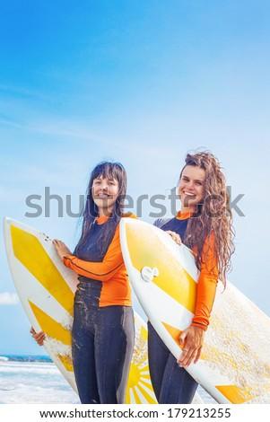 Surfer girls in Bali - stock photo