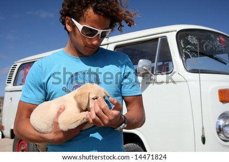 surfer guy and his dog - stock photo