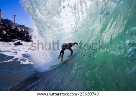 Surfer in Big Barrel, Getting Tubed - stock photo