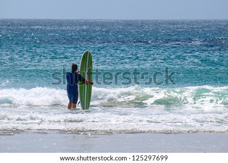Surfer in New Zealand