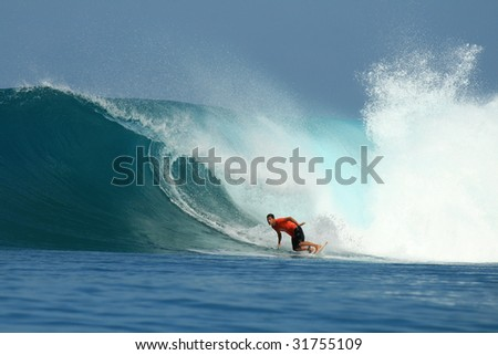 Surfer in red t-shirt on big wave, Mentawai Islands, Indonesia - stock photo