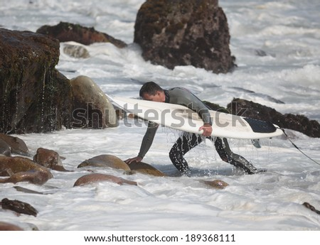 Surfer in the beach - stock photo