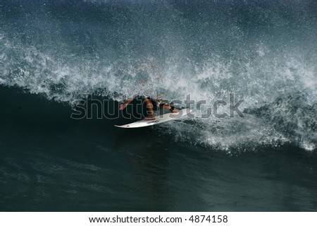 surfer in the tube