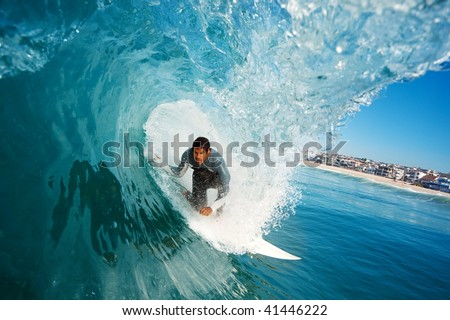 Surfer in the Tube on Perfect Blue Wave, A Surfer's Perspective - stock photo