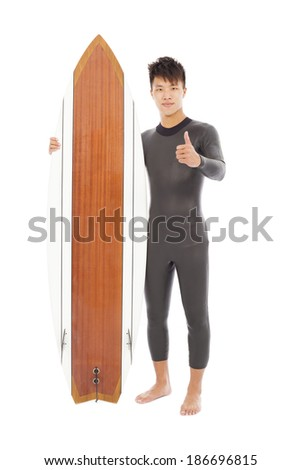 surfer man holding a surfboard and thumb up - stock photo