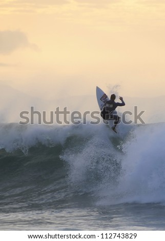 Surfer on a wave - stock photo