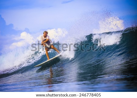 Surfer on Amazing Blue Wave, Bali island. - stock photo
