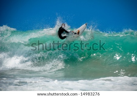 Surfer on an amazing wave on a perfect sunny day - stock photo