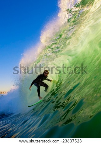 Surfer on Big Wave in Epic Tube - stock photo