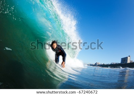 Surfer on Blue Wave Getting Barreled - stock photo