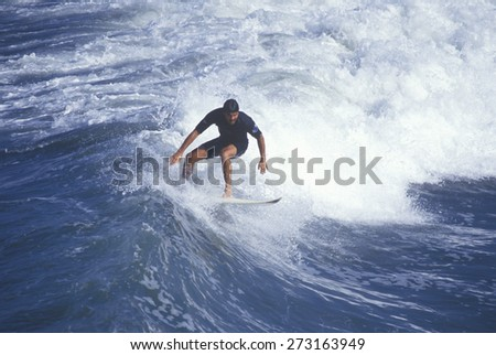 Surfer on crest of wave, Huntington Beach, CA - stock photo
