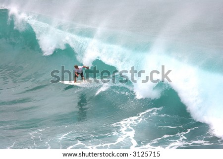 Surfer on large green wave