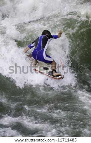 Surfer on riva Isar, Munich, Germany - stock photo