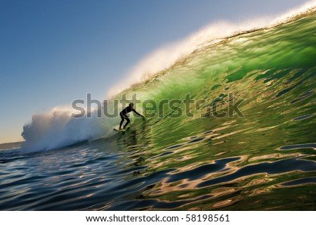 Surfer on Sunset Wave in California - stock photo