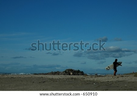 surfer on the beach - stock photo