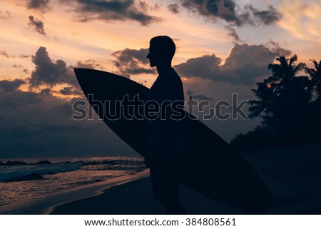 Surfer on the sunset - stock photo