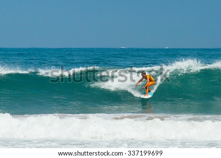 Surfer on the wave - stock photo