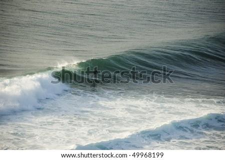 Surfer on the wave, Uluwatu, Bali, Indonesia. - stock photo