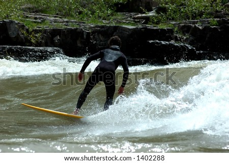 surfer on wave on the snake river - stock photo