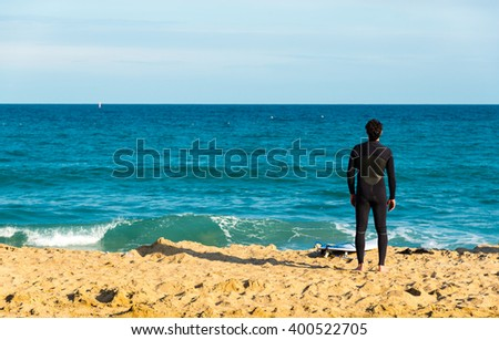 surfer preparing on the beach - stock photo