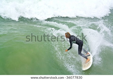 Surfer riding a wave with Copy Space - stock photo