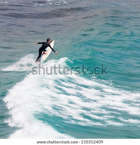 surfer riding alone on a windy day - stock photo