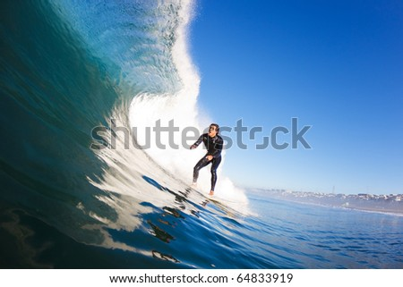 Surfer riding Large Blue Wave - stock photo