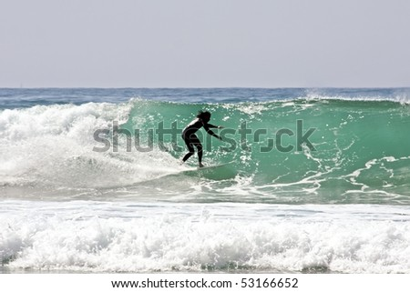 Surfer surfing the waves - stock photo