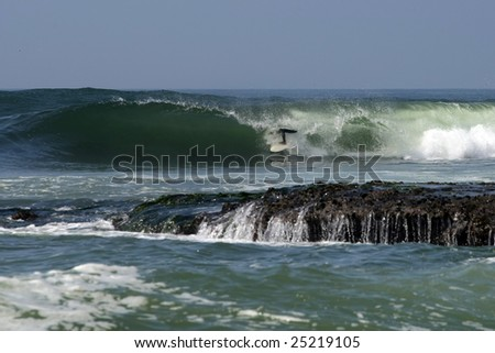 surfer taking a barrel in Abreojos, Mexico - stock photo