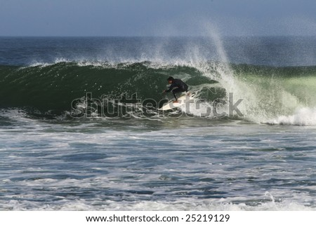 surfer taking a barrel in Abreojos, Mexico