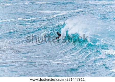 Surfer waiting for a perfect  wave. Big Island, Hawaii, USA - stock photo