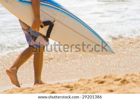 Surfer walking on sandy beach in Bali, Indonesia. - stock photo