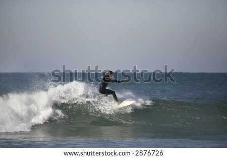 surfer with a blue sky