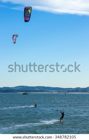 Surfer with kite surfing off the beach in Spain.Surfer with kite surfing - stock photo