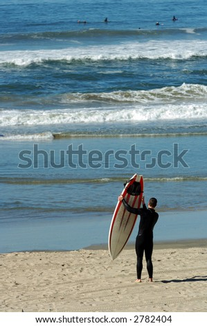 Surfer With Surfboard on California Beach - stock photo