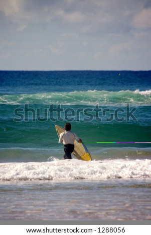 Surfer with surfing board - stock photo