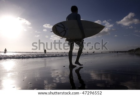 Surfer with the sunset - stock photo