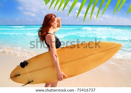 surfer woman side view tropical sea looking waves Caribbean sea [Photo Illustration] - stock photo